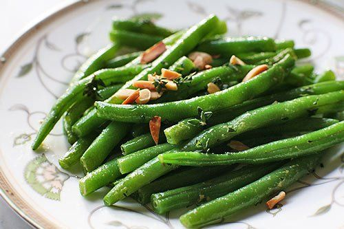 Green Beans with Almonds and Thyme ~ Recipe for green beans, boiled first, then sauteed in butter with thyme and toasted almonds. ~ SimplyRecipes.com