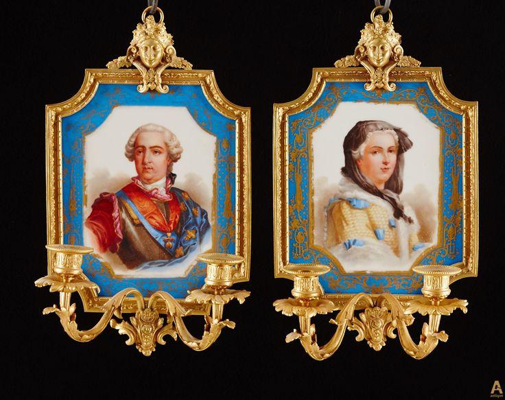 Пара импозантных настенных светильников, с фарфоровыми вставками с изображениями портретов короля и королевы Франции: Людовика XV и Марии Лещинской.