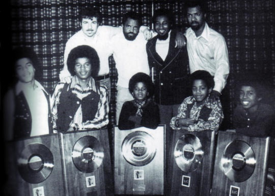 The Jackson 5 (from left, Tito, Jackie, Michael, Marlon and Jermaine) pose with their platinum records. Behind them stand the producers and songwriters dubbed The Corporation -- Deke Richards, Berry Gordy, Freddie Perren and Fonce Mizell.  Credit: Berry Gordy