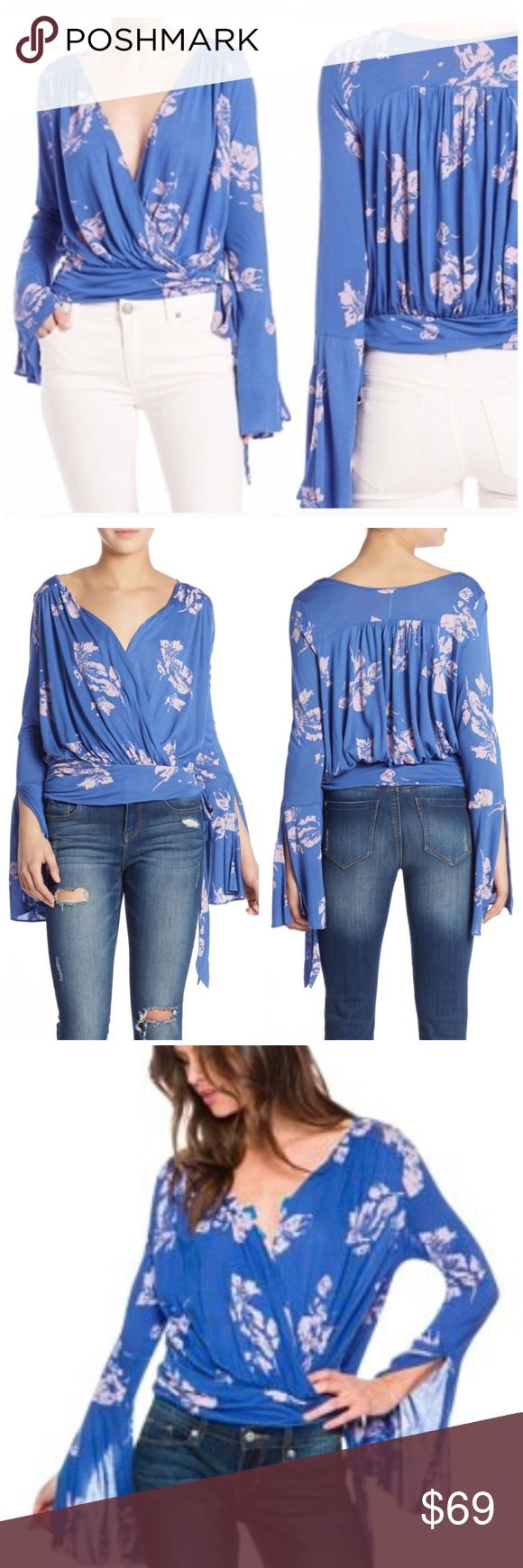 Free People Fiona Wrap Bell-Sleeve Boho Top Blue NWT Product Details: Rayon Machine washable Imported Plunging surplice neckline, Pullover style; ties at side, Long bell sleeves, Allover print, Wrap styling. Boho chic style. *Last two photos are actual item, all other photos are stock photos. Free People Tops Blouses