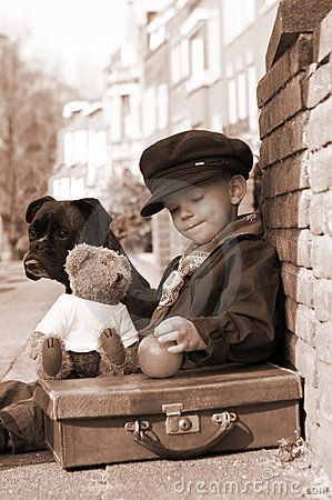 boy, dog and teddy bear. (fiction) Joseph Camden with teddy bear & briefcase Aubrie finds in the attic at Grace Bed & Breakfast in Stillwater Springs.