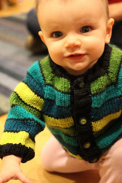 Easy to knit baby sweater made from a free pattern.