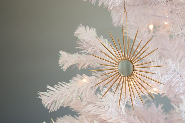 Learn how to create miniature sunburst mirror ornaments using toothpicks and tiny craft mirrors. These ornaments reflect holiday lights beautifully!