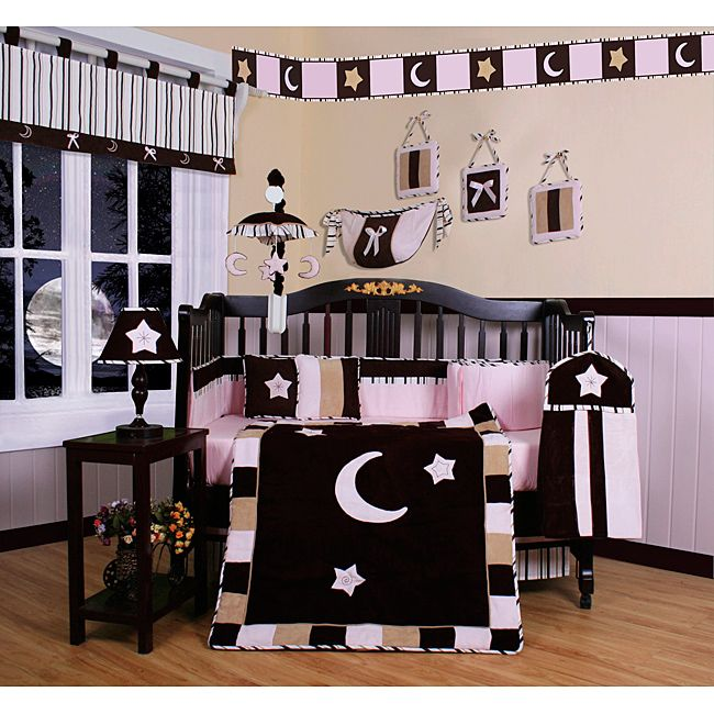 Dress up and decorate your baby girl's room with this beautiful 13-piece crib bedding set.This set includes a crib quilt, two valances, skirt, sheet, bumpers, diaper stacker, toy bag, two throw pillows and three wall hangings.