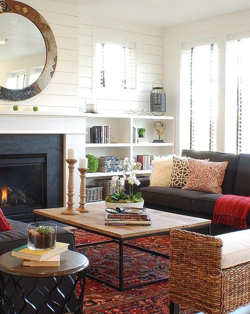 fireplace with built in bookcases on either side