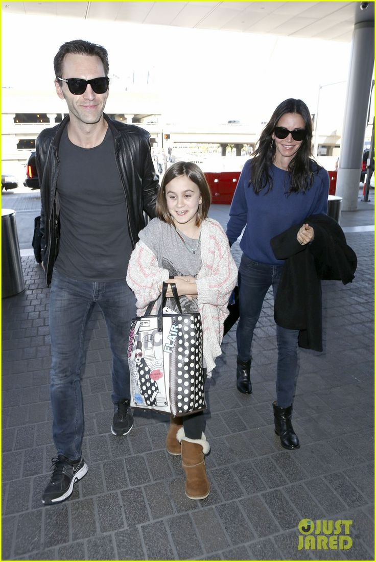 Courteney Cox and her boyfriend Johnny McDaid depart a flight at LAX Airport with her daughter Coco on February 14, 2014