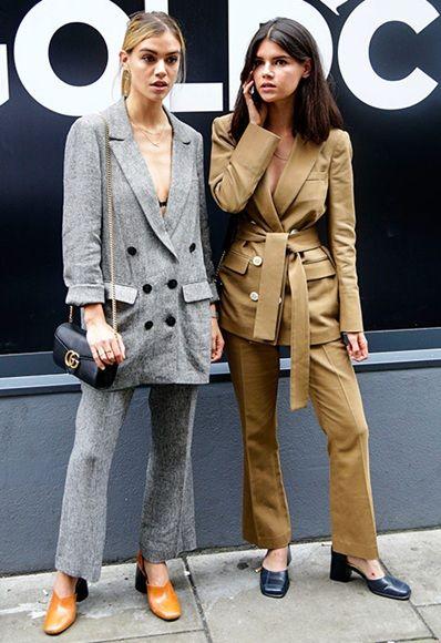 Joanna and Sarah Halpin at London Fashion Week wearing suits | ASOS Fashion & Beauty Feed