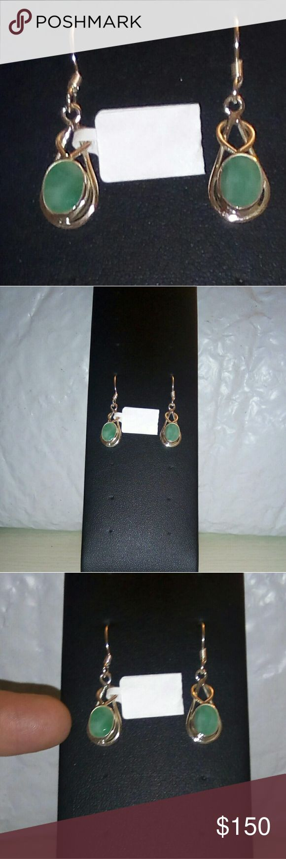 Brazilian Emerald Silver Earrings TGW 2.46cts. Brazilian Emerald Silver Earrings TGW 2.46cts.  #72232.  MFSR $300.  May birthstone said to be a stone of wisdom, enhancing memory & increasing mental clarity. It combines intelligence with discernment & brings to the conscious mind what is unconsciously known. To keep silver from tarnishing use pouch and anti-tarnish piece included when not wearing.  Please do not remove secure tab label until sure you want to keep.  Avoid harsh soaps and…