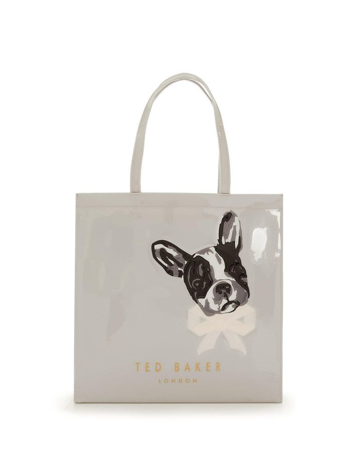 Ted Baker Large Embossed Icon Shopper They call it puppy love for a reason and this Icon Shopper by Ted Baker pops a French bulldog print on the front of this bag for plenty of charm, character and cuteness this season! The contrasting lining and zip pocket create a cute contrast of hues as well as a place to store your valuables separately making this a key part of your handbag collection.Large and roomy, this shopper will easily tote about your must-haves from the office to weekend…