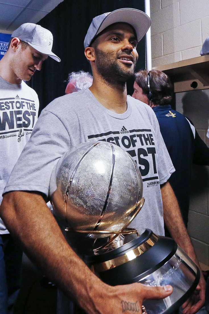 A LITTLE HARDWARE San Antonio Spurs guard Tony Parker, of France, holds the Western Conference Champion trophy after defeating the Memphis Grizzlies 93-86 in Game 4 of the conference NBA basketball playoff series, Monday, May 27, 2013, in Memphis, Tenn. San Antonio advances to the NBA finals. (AP Photo/Rogelio V. Solis, Pool) MORE NBA PLAYOFFS PHOTOS HERE