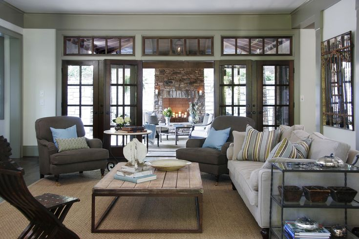 Family Room - the furniture is a little more traditional, but I like the flow between the two rooms...and those windows & doors!