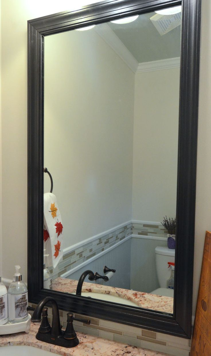 Plain, frameless mirrors are boring. If your mirrors have clips, then this tutorial is for you. How to frame your bathroom mirror with clips in 5 easy steps