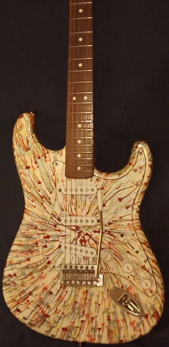 Fender Splattercaster. In 2003, only 220 wheel-spun Stratocasters were painted in three color combinations. They have since steadily increased in value among collectors, and still offer huge bang for the bucks. No middle ground with these; one either loves or hates them. For me, this one is a keeper. I dare say it rivals some American Strats I have owned. Another Craigslist steal. It has sat in the hard case since bought, and is still in like-new condition.