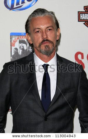 """LOS ANGELES - SEP 8:  Tommy Flanagan arrives at the """"Sons of Anarchy"""" Season 5 Premiere Screening at Village Theater on September 8, 2012 in Westwood, CA by Helga Esteb, via ShutterStock"""