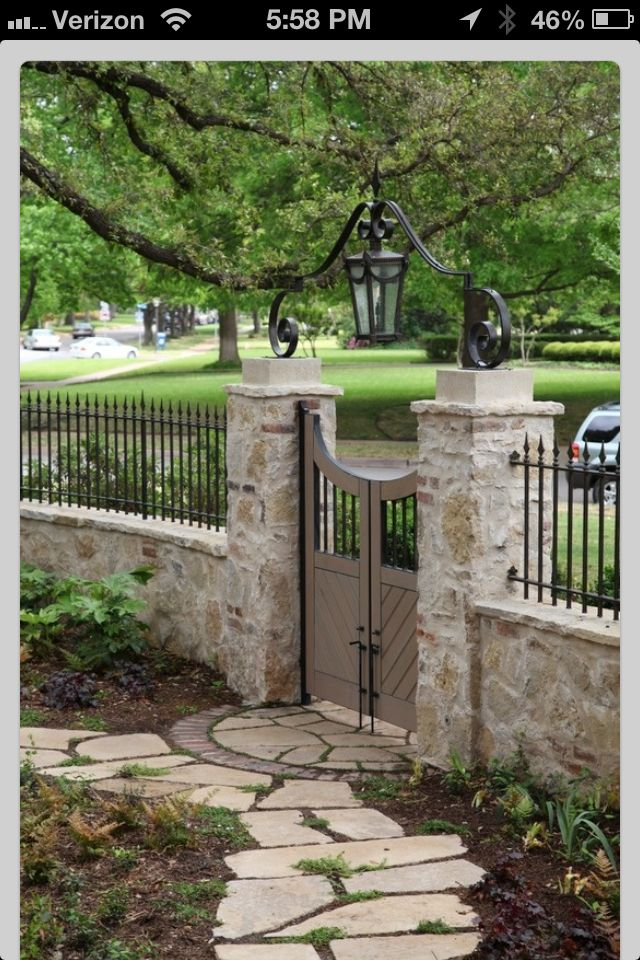 Wouldn't this be lovely in the front yard?? A little bit lower though - really maybe only 2 feet tall for the stone wall and 2' or 3' for the wrought iron