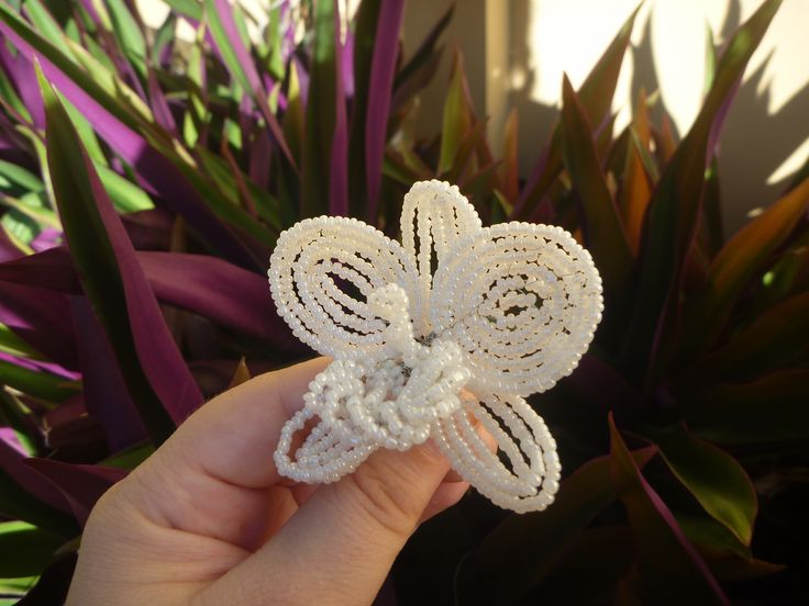 A simple beaded orchid, created with wire and glass seed beads.
