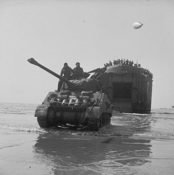 BRITISH ARMY NORMANDY (B 5130)   A Sherman Firefly coming ashore from an LST (Landing Ship Tank), Sword Beach, 7 June 1944.