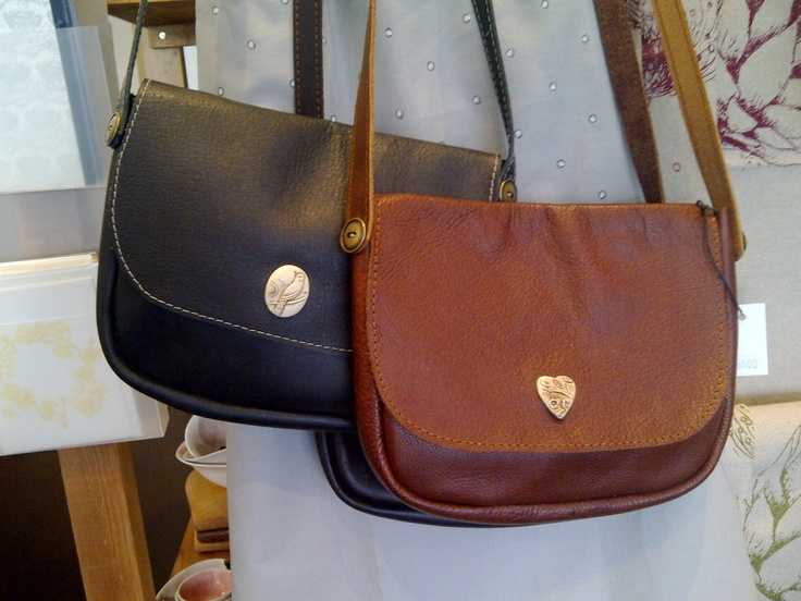 Soft leather sling bag with the most beautiful handmade badge