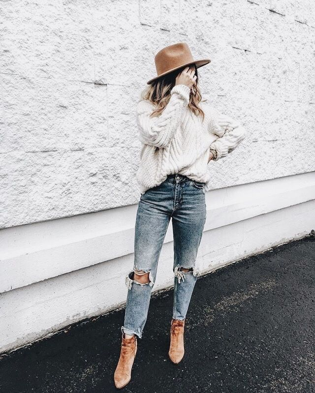 ivory jackard sweater and ripped jeans