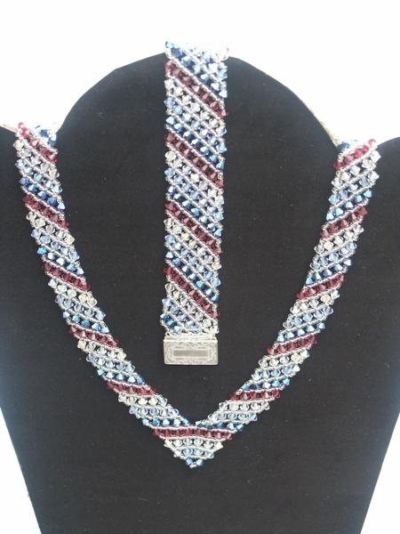 very beautiful and elegant Swarovski set, a V  necklace and bracelet
