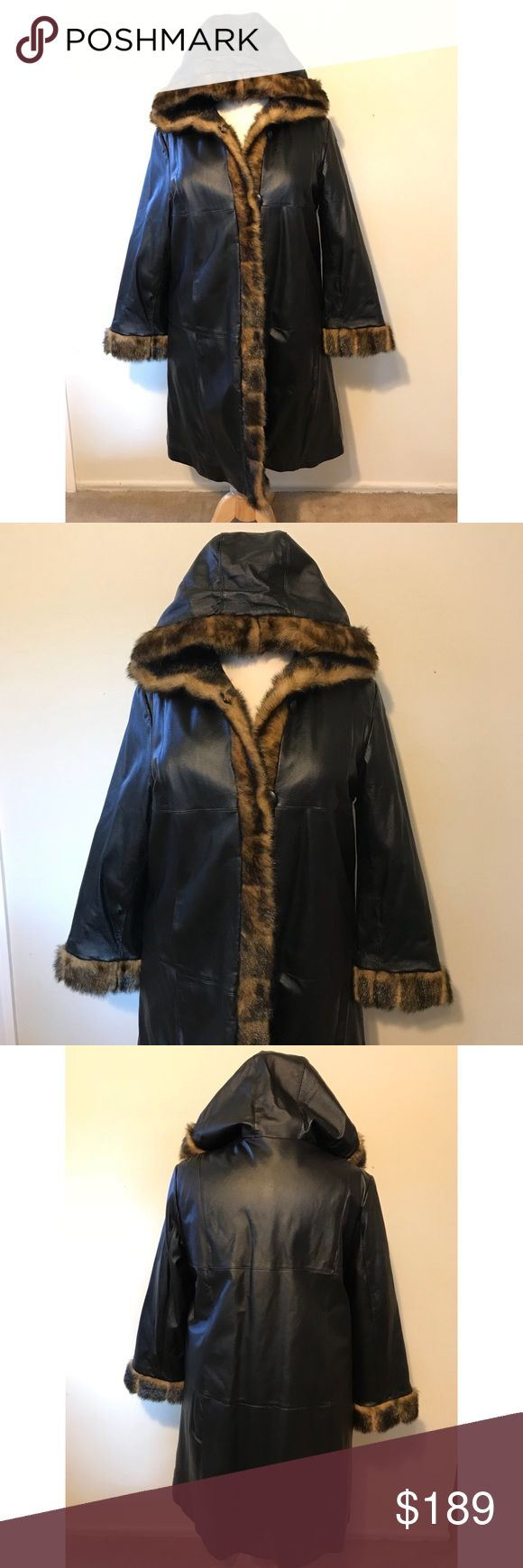 Terry Lewis leather trench coat w/ fur trim 1X The jacket is made of black genuine leather with a faux fur trim around the hood, cuffs & down the front. The interior is in pristine condition and has a black quilted pattern to it. It has 4 original buttons with leather loops to close the front. This jacket has only been worn once and then stored in a coat closet so it's in excellent condition except for one loose stitch on the seam at the right shoulder. All measurements have been taken from…