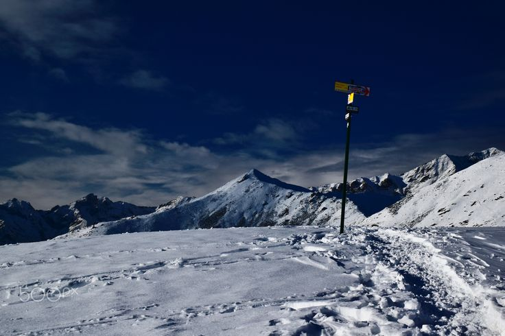 the climb to the mountain - in the snow, the path that leads to the summit of the mountain, near the trail                        in the snow, the path that leads to the summit of the mountain, near the trail