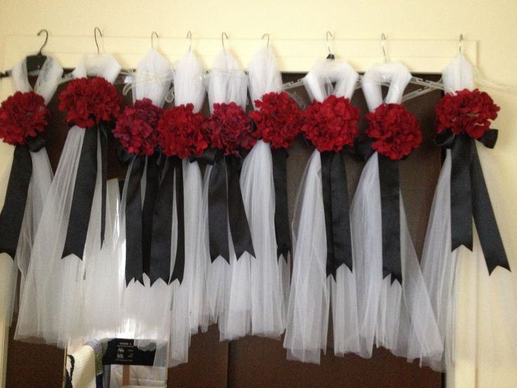 DIY pew decorations. Not sure if  we are doing something but just the white tulle and black ribbon, no flowers for the aisle chairs