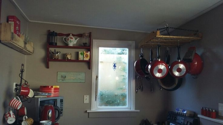 Kitchen: pellet shelf $5 materials, pot rack, $20 materials, red shelf up cycled from dump.