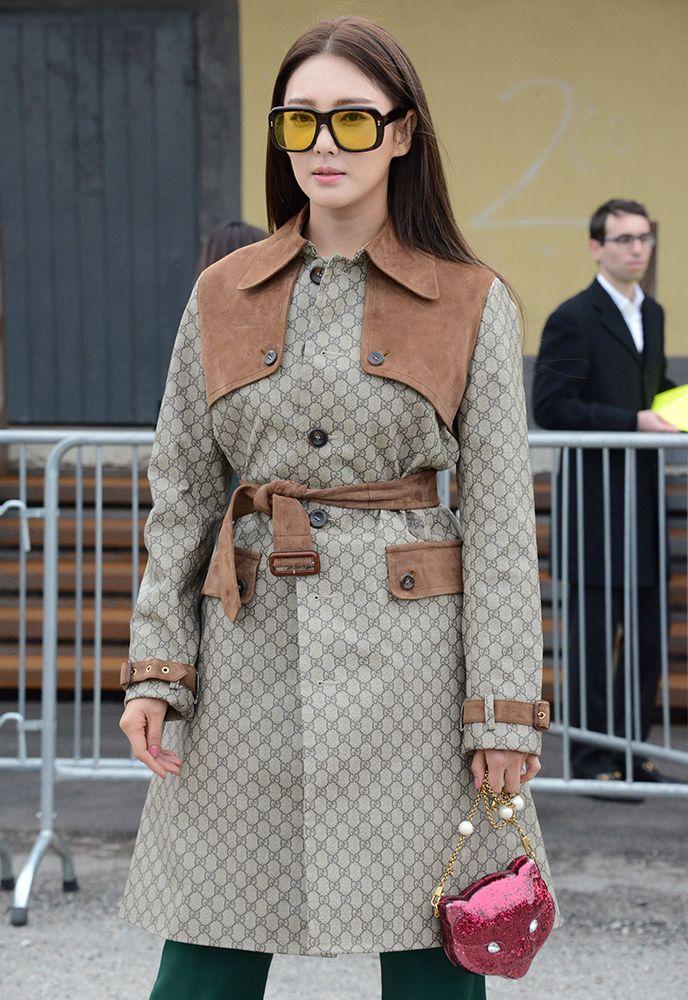 Zhang Yuqi with a Gucci Glitter Plexi Cat Clutch and Gucci coat
