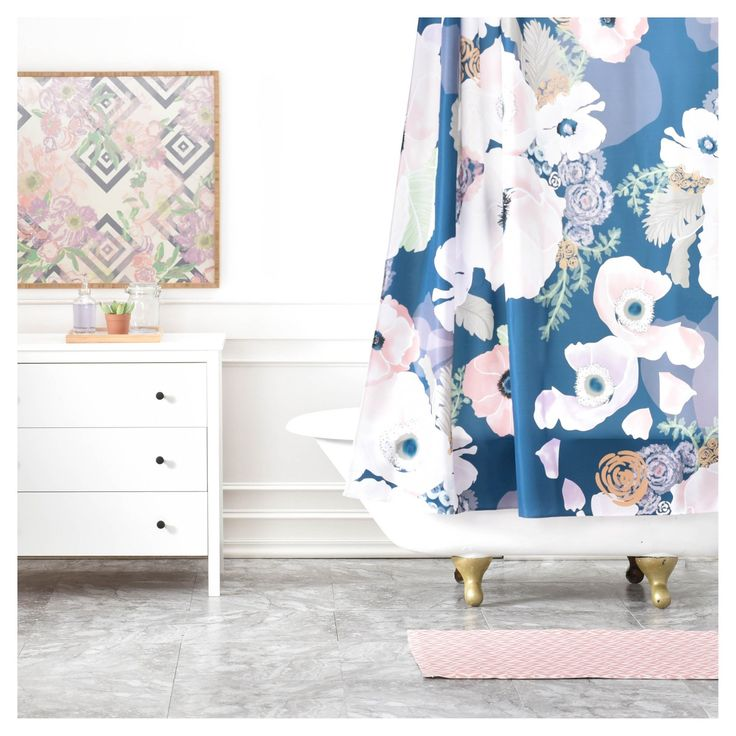 Who says bathrooms can't be fun? Custom made in Denver, CO of machine washable woven polyester, the DENY Designs Khristian A Howell Une Femme In Blue Shower Curtain will add just the right amount of pop to any bathroom!