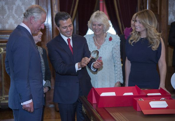 Prince Charles, Prince of Wales (L) and Camilla, Duchess of Cornwall receive an official welcome from President Enrique Pena Nieto and the First Lady Anjelica Rivera while the President shows the royal couple the Trees of Life he presented to them at the Palacio National on November 3, 2014 in Mexico City, Mexico. The Royal Couple are on the second day of a four day visit to Mexico as part of a Royal tour to Colombia and Mexico.