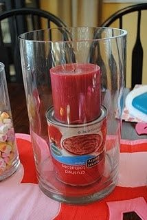 Tip of the day Place a can under a candle in a large vase — you'll use less filler AND the candle will sit straight!!