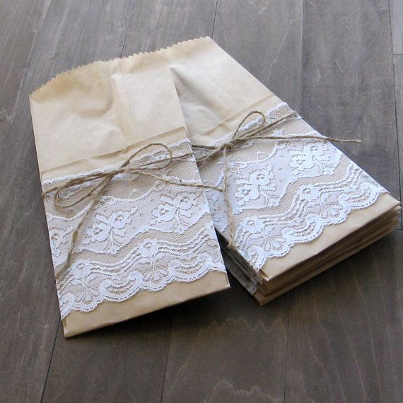 White lace utensil pockets (4) - silverware pockets, cottage chic place setting - entertaining kraft brown kraft and lace. $8.00, via Etsy.