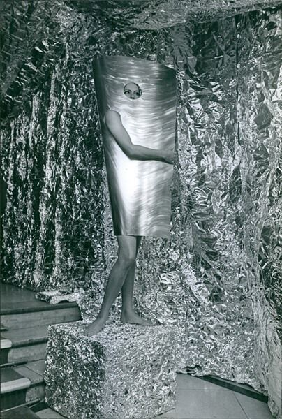 Vintage photo of Woman covering her body with sheet. -