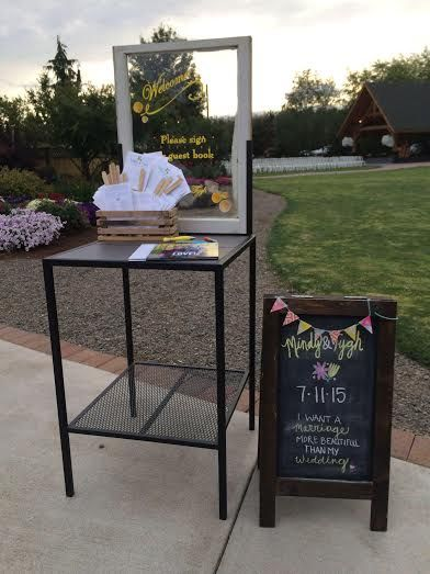 Here is Garden Gallery Iron Works window potting table. This couple used it for a guest book sign in. Wrote right on the glass. What a great idea. Congratulation Tygh and Mindy!