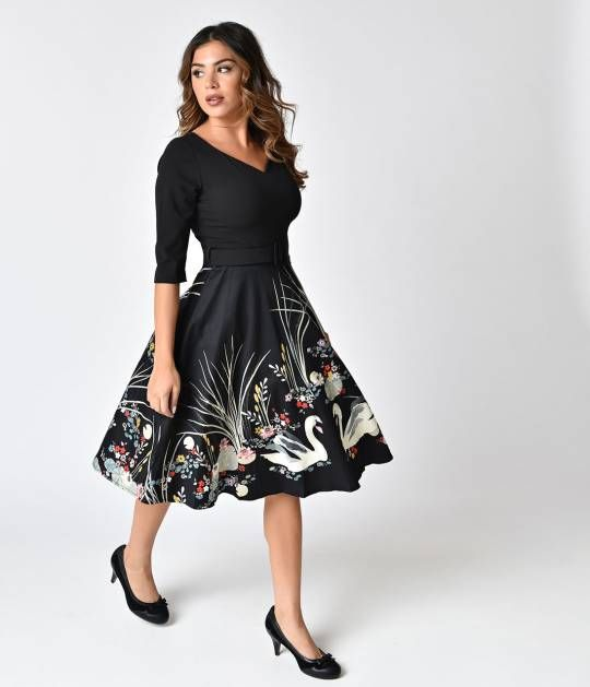 Take a swan dive into vintage love, dames! A gorgeous 1950s style swing dress, this elegant black piece is cast in a fabulously stretch blend and boasts a gorgeous swan scene print on the skirt. The modest V-neckline is framed by three-quarter length slee