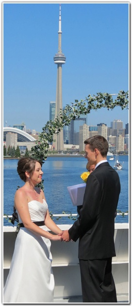 Bride And Groom Exchanging Their Wedding Vows On The Upper Deck Of Cruise Boat Yankee