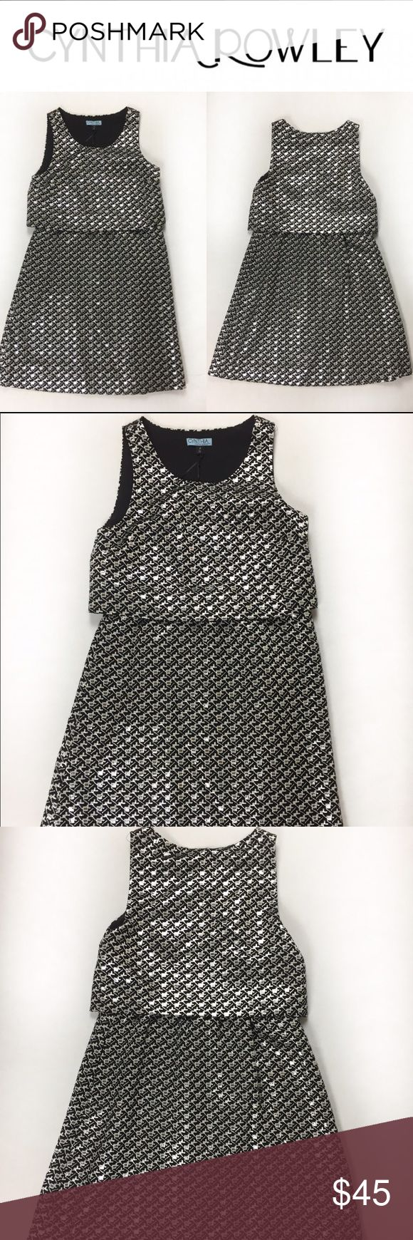 SALE! Cynthia Rowley black and silver dress SZ 4 Gorgeous Cynthia Rowley houndstooth black and silver mini dress, has an elastic in the middle creating a 2 piece dress effect. It's stunning, pictures do no justice! This is a brand new item without tags since it was a present, unfortunately does not fit me. Love it? Make an offer! Questions? Ask me!  Cynthia Rowley Dresses Mini