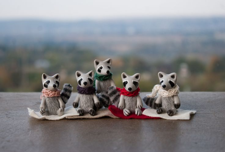 It's a cute raccoon in a matchbox with drops.   The raccoon wears a hand knitted scarf. It have mohair body. The tail has wire frame, stripes painted by acrylic paints. The raccoon can sit...