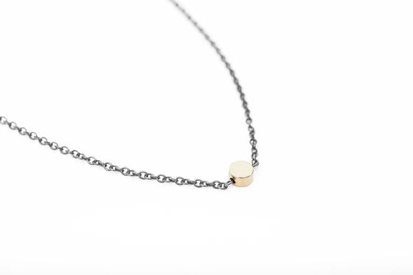 Minimalist silver necklace with a single circle bead plated with shiny 16k gold. Simple and classic necklace that compliments both your everyday and party looks.