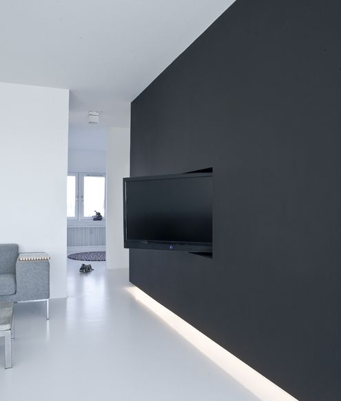 charcoal black wall with integrated flatscreen | floor downlighting