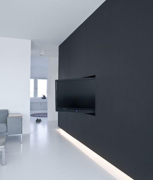 black wall hidden tv