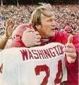 Barry Switzer hugging Joe Washington