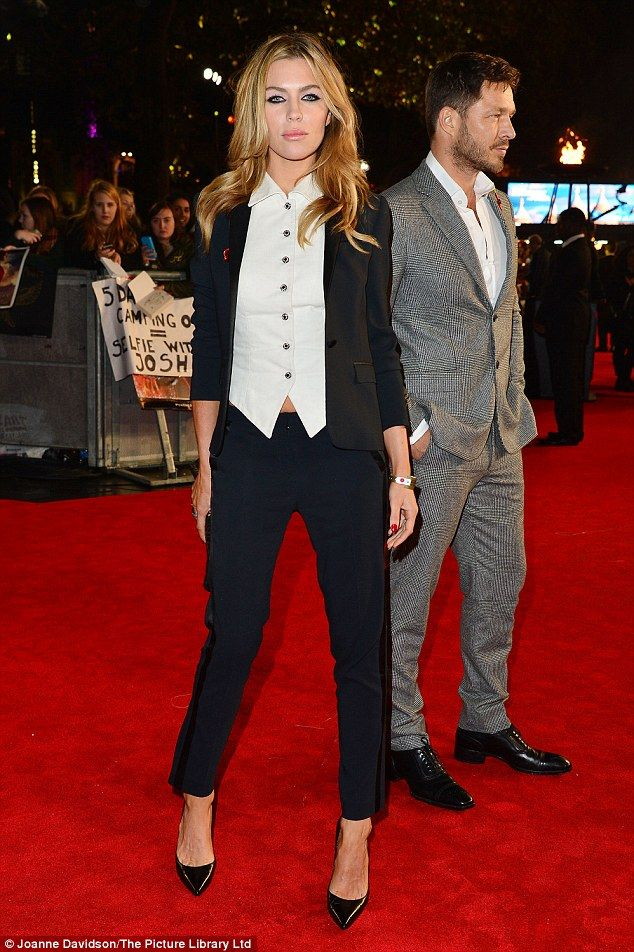 Suits you!Abbey Clancy was showing off her trim figure as she went for the androgynous look at The Hunger Games: Mockingjay - part 2 UK premiere in London's Leicester Square on Thursday night