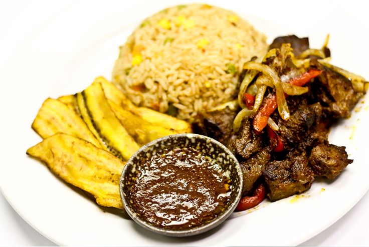 Beef Bite and jellof rice served with plantains and pepper sauce - by Charcol Restaurant & Grill Plano TX