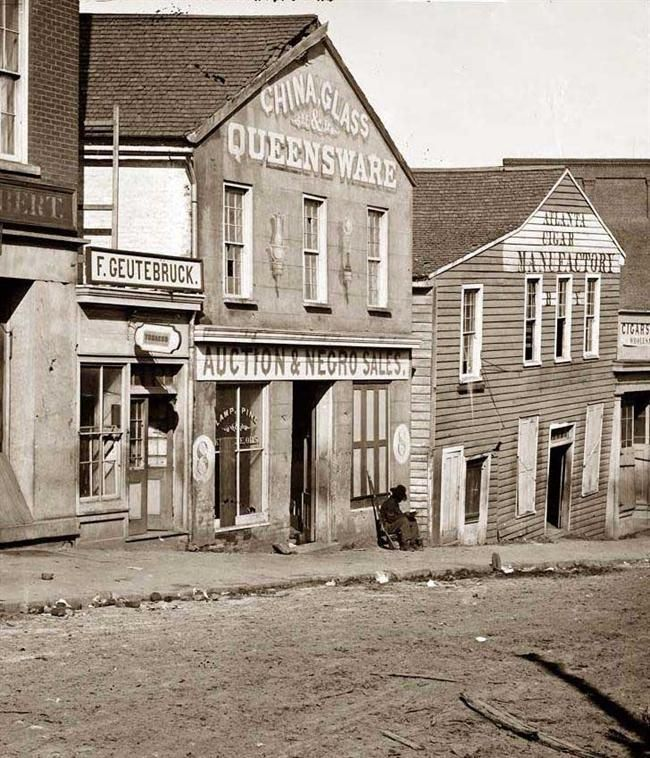 "The merchandise being auctioned is described by a chilling sign on the front of the establishment, ""Auction and Negro Sales"". The building is a slave auction house in the south. While this is a very sad picture, taken in 1864, the institution of slavery was near extinction in the US. Slavery would end in 1865 with Lee's surrender to Grant at Appomattox Courthouse. Happily on this day (July 28) in the year 1868, the 14th amendment to the US constitution was passed, giving full citizenship to…"