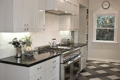 Love the white cupboards, stainless steel appliances, and black marble