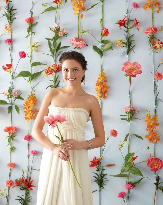 Assemble your own multicolored flower wall by taping vertical rows of long-stemmed varieties to a wall. Use blooms less prone to wilting, like peonies, carnations, orchids, and lilies. You can either let the strips of tape show—or hide them under petals and leaves. We recommend using Shurtape masking tape for best results.