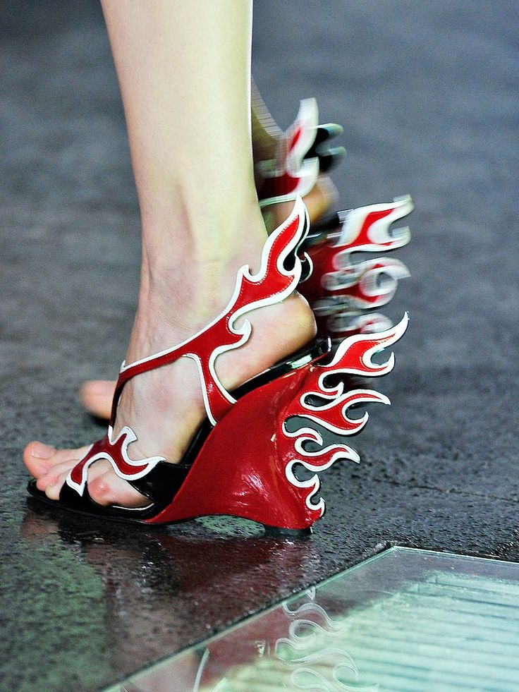 these shoes from prada's spring 2012 collection rule, but what's with those feet?! pedicures are cheap, prada--get on it!