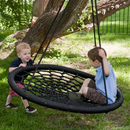 So much cooler than a tire swing and it won't collect water! This looks like a ton of fun!